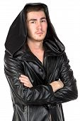 Image of the young man dressed in hooded cloak