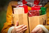 In hands there is lot of Christmas presents