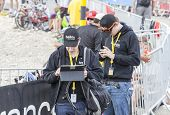 People Using Modern Electronic Devices To Transmit Data - Tour De France 2013