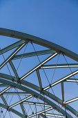 Curved Steel Architecture On Blue Sky