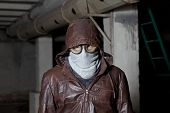 Guy in mask and safety glasses hooded jacket