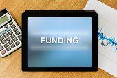 Funding Word On Digital Tablet