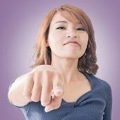 Serious Asian woman point at you, closeup portrait.