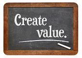 create value - advice or reminder on a vintage slate blackboard