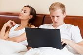 Laptop In Couple's Bed