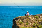 Fisherman On The Rocks,ribadeo, Spain
