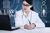 Female Doctor Working At The Desk