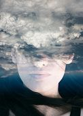picture of surreal  - Dream like surreal double exposure portrait of attractive lady combined with aerial view photograph - JPG