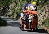 MADAGASCAR- DECEMBER 23, 2013. Overloaded bus moves in the mountains of the island of Madagascar