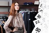 Lovely woman is in the shopping center. Sale of clothing