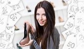 Portrait of woman keeping coffee-colored leather shoe in shopping center. Christmas sale