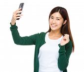 Asian young woman take selfie