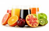 pic of fruit-juice  - Composition with glasses of assorted fruit juices isolated on white - JPG