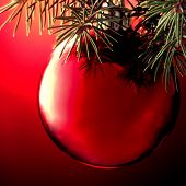 Christmas ball on a Christmas tree with red background
