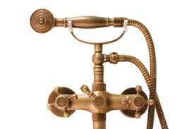 foto of douching  - close up vintage brass douche isolated on white background - JPG