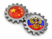 pic of snatch  - Russian and Chinese flags on a gears - JPG