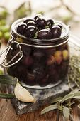 stock photo of kalamata olives  - jar with pickled kalamata olives - JPG