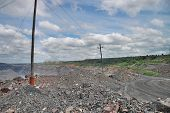 stock photo of iron ore  - General view to the iron ore opencast mining - JPG
