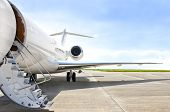 picture of jet  - Stairs with Jet Engine on a modern private jet airplane - JPG