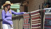 foto of cowgirls  - A Beautiful Brunette Cowgirl Shops for Handmade Native American Blankets - JPG