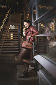 picture of ladies night  - Woman with leather handbag is standing in night street - JPG