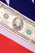 picture of ten thousand dollars cash  - ten dollars on american flag - JPG