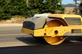picture of paved road  - Drum tandem vibratory rollers compacting down a fresh layer of paving on a new road interchange project - JPG