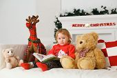 picture of girl toy  - little baby girl reading a book in his toys Christmas decorations - JPG