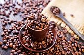 stock photo of pot roast  - coffee beans on the wooden table roast coffee beans - JPG