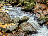 pic of flow  - a creek with rocks and flowing water - JPG