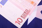 picture of american money  - european money on american flag - JPG