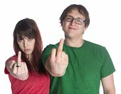 stock photo of fuck  - Close up Young Couple in Red and Green Casual Shirts Showing Fuck You Finger Signs While Looking at the Camera - JPG