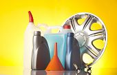 image of alloy  - alloy wheel and windshield washer fluids and bottles of motor oil - JPG