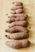 pic of batata  - pile of sweet potatoes on wooden background - JPG