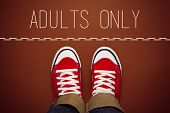 picture of adults only  - Adults Only Concept Young Teenage Person in Red Sneakers Standing at Dividing Line of Restricted Area - JPG