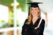 stock photo of graduation gown  - Graduation of a woman dressed in a black gown - JPG
