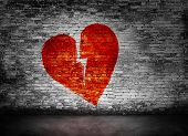picture of broken heart  - Shape of broken heart on murky brick wall - JPG