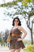 picture of leopard  - Portrait of pretty plus size woman wearing short leopard dress - JPG