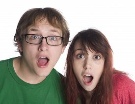 pic of shock awe  - Close up Shocked Young Couple with Mouth and Eyes Wide Open Looking at Camera - JPG