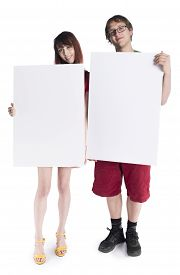 stock photo of lobbyist  - Full Length Shot of Smiling Young Couple Holding Empty White Card Boards - JPG