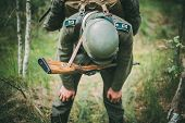 Постер, плакат: Unidentified re enactor dressed as German soldier during events