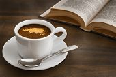 stock photo of continent  - Still life photography of hot coffee beverage with map of EurAsia continent - JPG