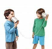 foto of tin can phone  - Two boys talking on a tin can phone isolated on white - JPG