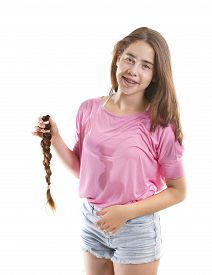 picture of generous  - Teenage girl in pink donating her hair to cancer patients  - JPG