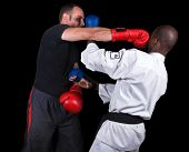 stock photo of pugilistic  - Ultimate fighting extreme sports kickboxing versus karate Caucasian and African American  - JPG