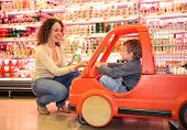 Child Mother  In Supermarket