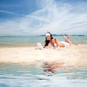 image of summer beach  - Cute woman with white laptop on the summer beach - JPG