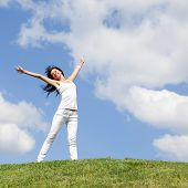 stock photo of young women  - happy young woman dreams to fly on winds - JPG
