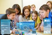 education, elementary school, learning, technology and people concept - group of kids with teacher l poster