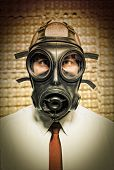 pic of s10  - businessman with gas mask and grunge background - JPG